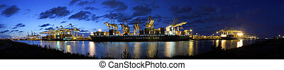 Container harbor during twilight - Three container vessels...