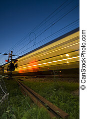 Passing Train - A train at full speed passing a railway...