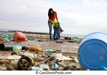 Strong young woman cleaning and volunteering - Ecological...