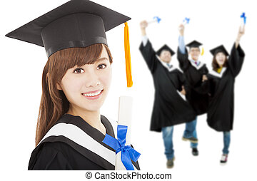 Young graduate girl student holding  diploma with classmates