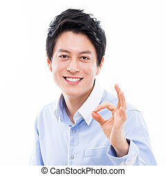 Young asian man showing okay sign. - Young asian man showing...