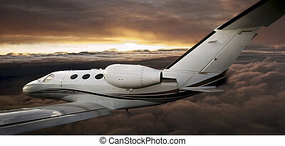 Executive in flight at sunset - Executive plane flying...