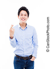 Young asian man showing lucky sign. - Young asian man...