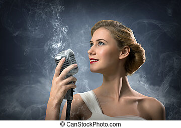 beautiful blonde woman singer with a microphone, eyes...