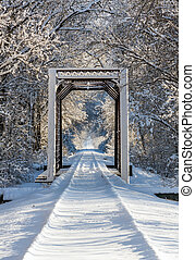 Snowy Train Trestle - An iron train trestle and railroad...