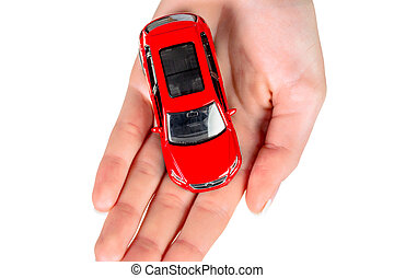 hand holding model of a car isolated against a white...