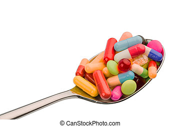many tablets on spoon - many colorful pills on a spoon...