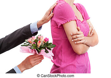 Flowers as consolation - A man giving his girlfriend flowers...