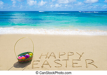 Sign quot;Happy Easterquot; with basket on the beach - Sign...