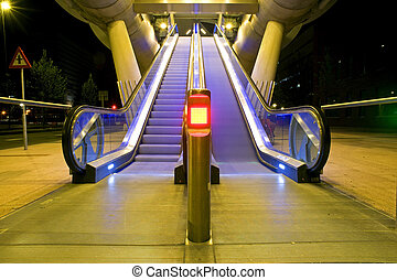 Escalator - Two escalators, one moving, the other standing...