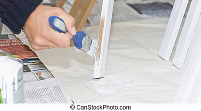 Painting - A female hand putting a primer on wooden beams...