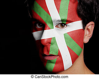 Flag of Basque Country Painted on a Face of a Young Man