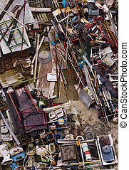 Junkyard - Top view of a junkyard with a chaotic load of...