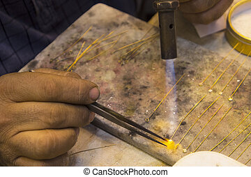 Gold and blowtorch handcraft in Iraq - Iraqi gold processing...