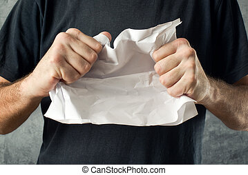 Man tearing contract paper - Man tearing conctract paper....
