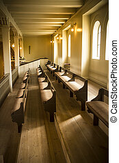 Church pews - Warm natural light on lines of church pews at...