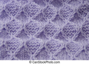 chequered knitting design - closeup of a chequered knitting...