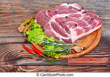 Raw meat selection with herbs and pepper
