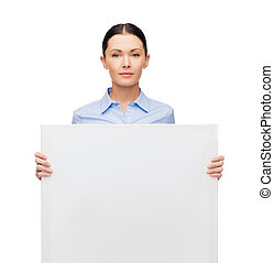 serious businesswoman with white blank board - business and...