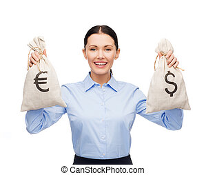 businesswoman holding bags with dollar and euro - business...