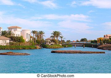 Beach, villas, bridge