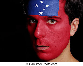 Flag of Samoa Painted on a Face of a Young Man
