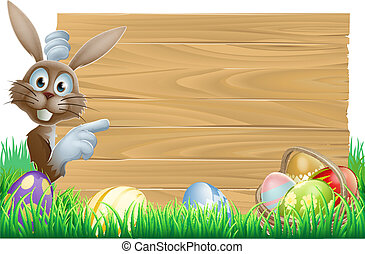 Easter bunny pointing at sign - Cartoon Easter rabbit bunny...