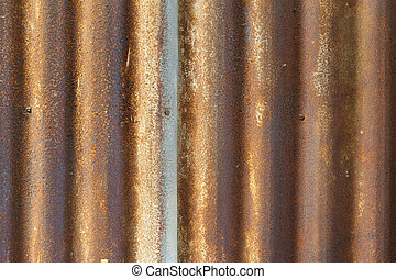 Rusty old corrugated iron fence close up