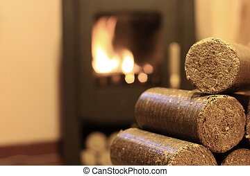 Wood briquettes for stoves background with fire