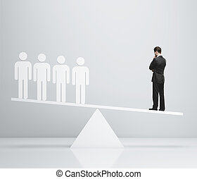 scales concept - businessman and 3d people on scales
