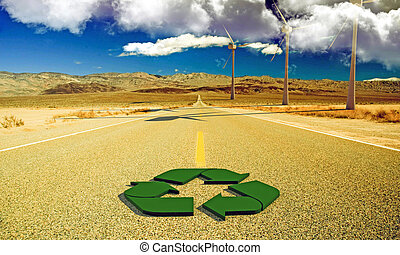 recycle sign on a desert road - green recycle sign on a...
