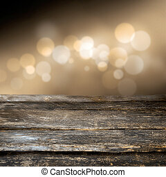 Grungy weathered wooden plank with a background bokeh of...