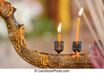 burning candles in temple