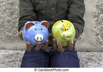 Child Holding two money boxes II - Child with two money...