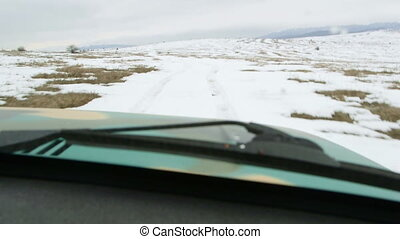 Off-road vehicle driving in the snow POV - Driving off-road...