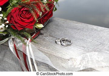 Rose bouquet with wedding rings