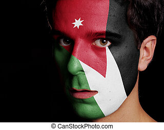 Flag of Jordan Painted on a Face of a Young Man