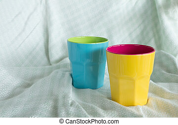 Blue and yellow cup on silk tablemat