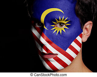 Flag of Malaysia Painted on a Face of a Young Man