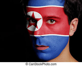 Flag of North Korea Painted on a Face of a Young Man