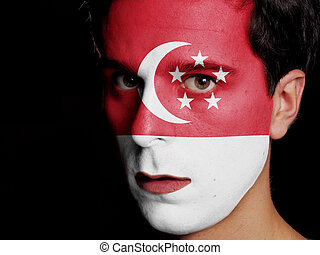 Flag of Singapore Painted on a Face of a Young Man