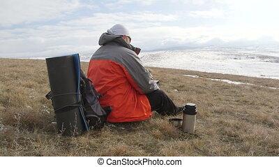 Traveller using digital tablet for navigation on the...