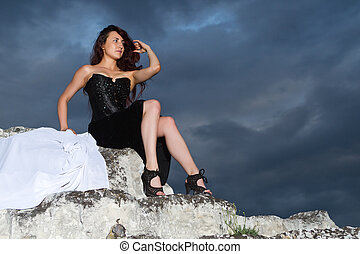 beautiful young woman in a black dress