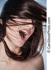 Nymphomaniac - Portrait of a young woman shouting in ecstasy