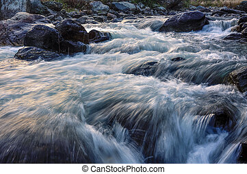 River water flowing through rocks at dawn - Reshi River...