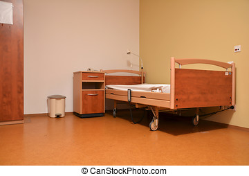 bed - empty room in a nursing home