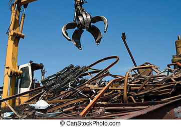 Scrapyard grabber - Mechanical grabber working in a...