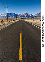 Road to mountains with telephone poles on side - Single...