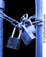 Locks and Chain Security - Several Locks and chain on fence...