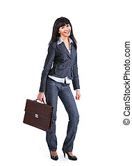 Full length image of confident business woman holding a...